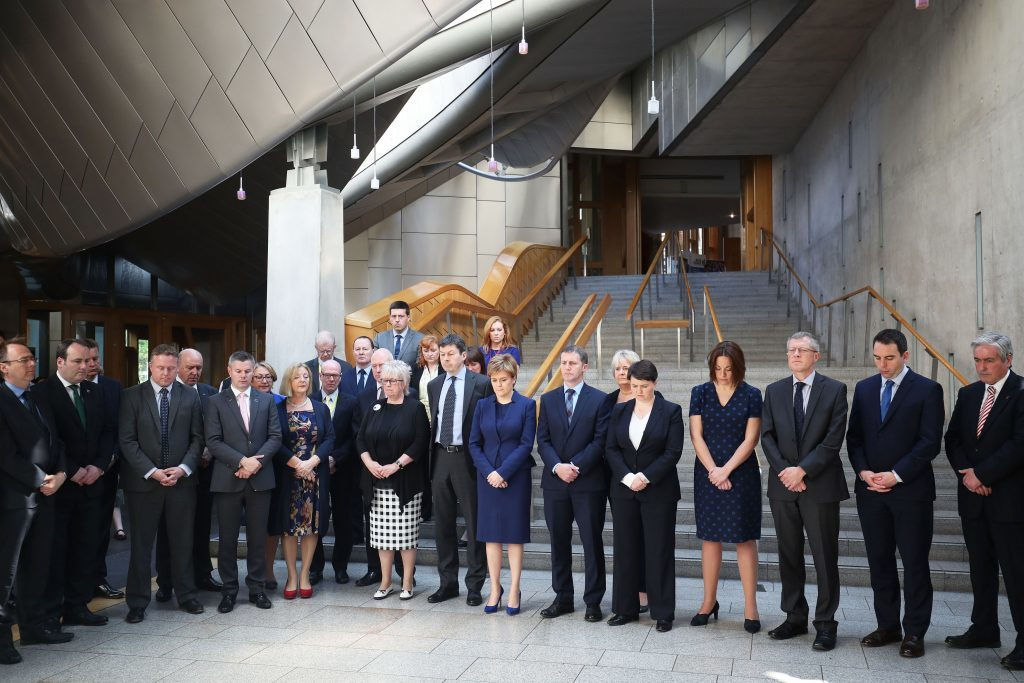 First Minister Nicola Sturgeon joins colleagues in observing a minute's silence in the Garden Lobby of the Scottish Parliament in Edinburgh to remember the victims of the terror attack in Manchester.