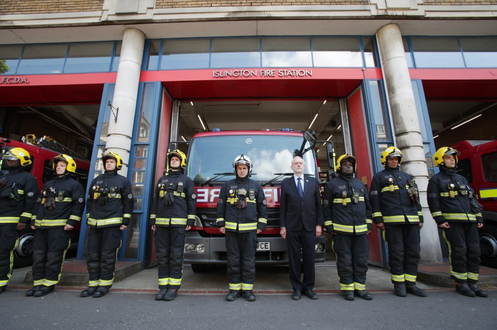 Labour leader Jeremy Corbyn (centre) joins fire fighters at Islington Fire Station, north London, as he observes a minute's silence to remember the victims of the Manchester terror attack.