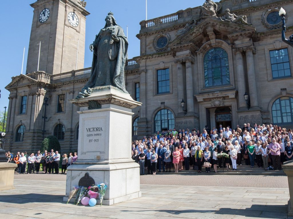 People observe a minute's silence outside South Shields town hall, the home town of victims Chloe Rutherford and Liam Curry.