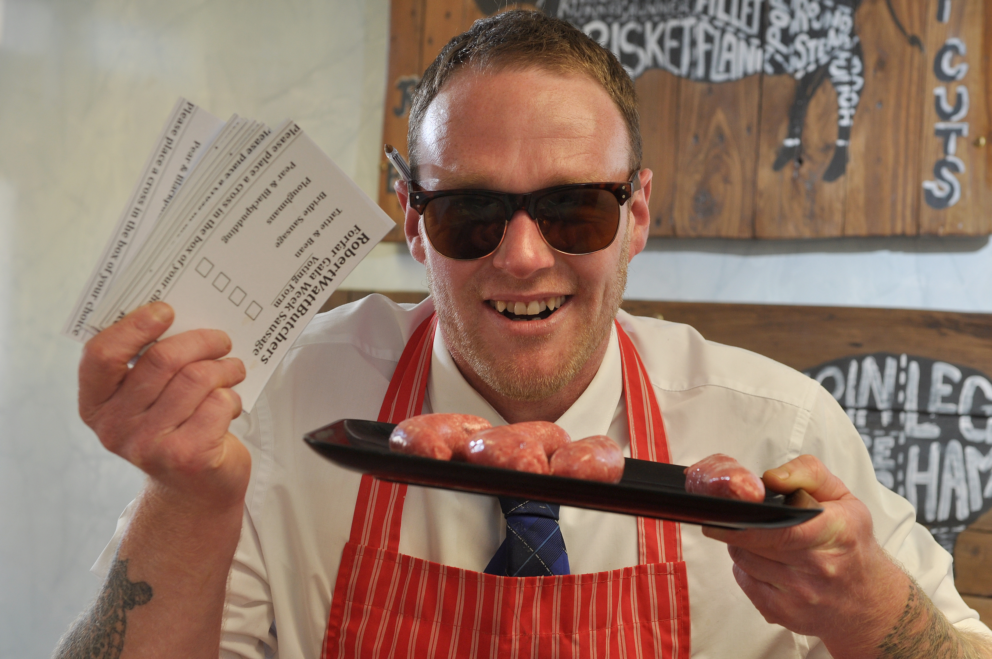 Kris Davidson with polling cards and some of the sausages