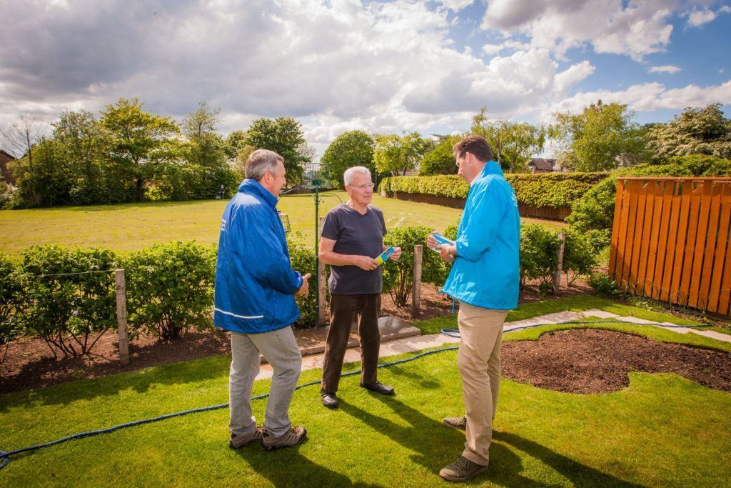 Councillor Angus Forbes and Ian Duncan chat to Inchture resident Brian Brogan.