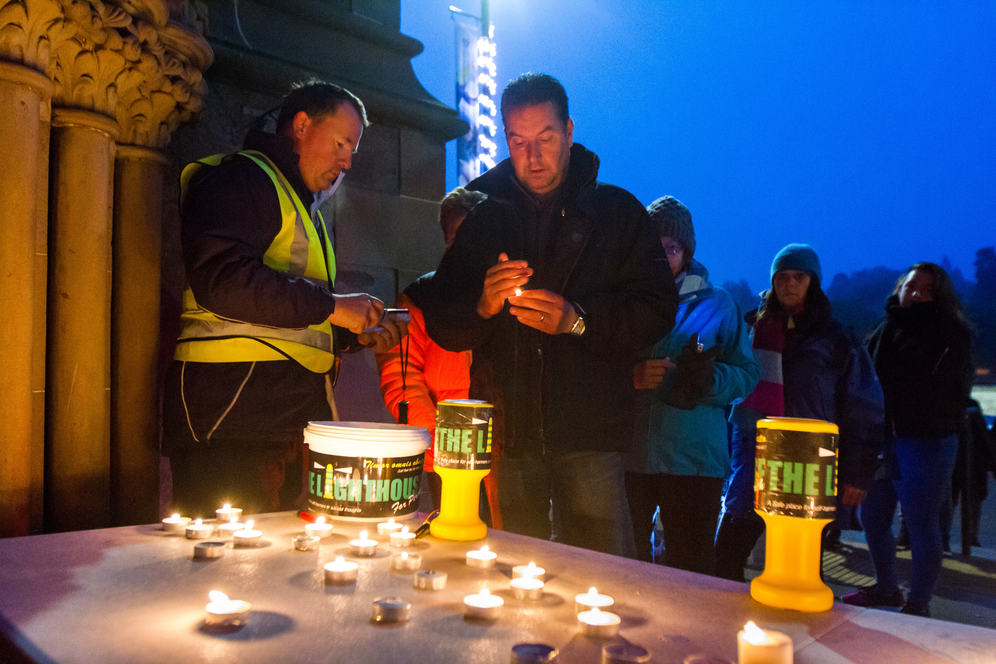 Walkers stop to light candles outside St Matthews Church on Tay Street.