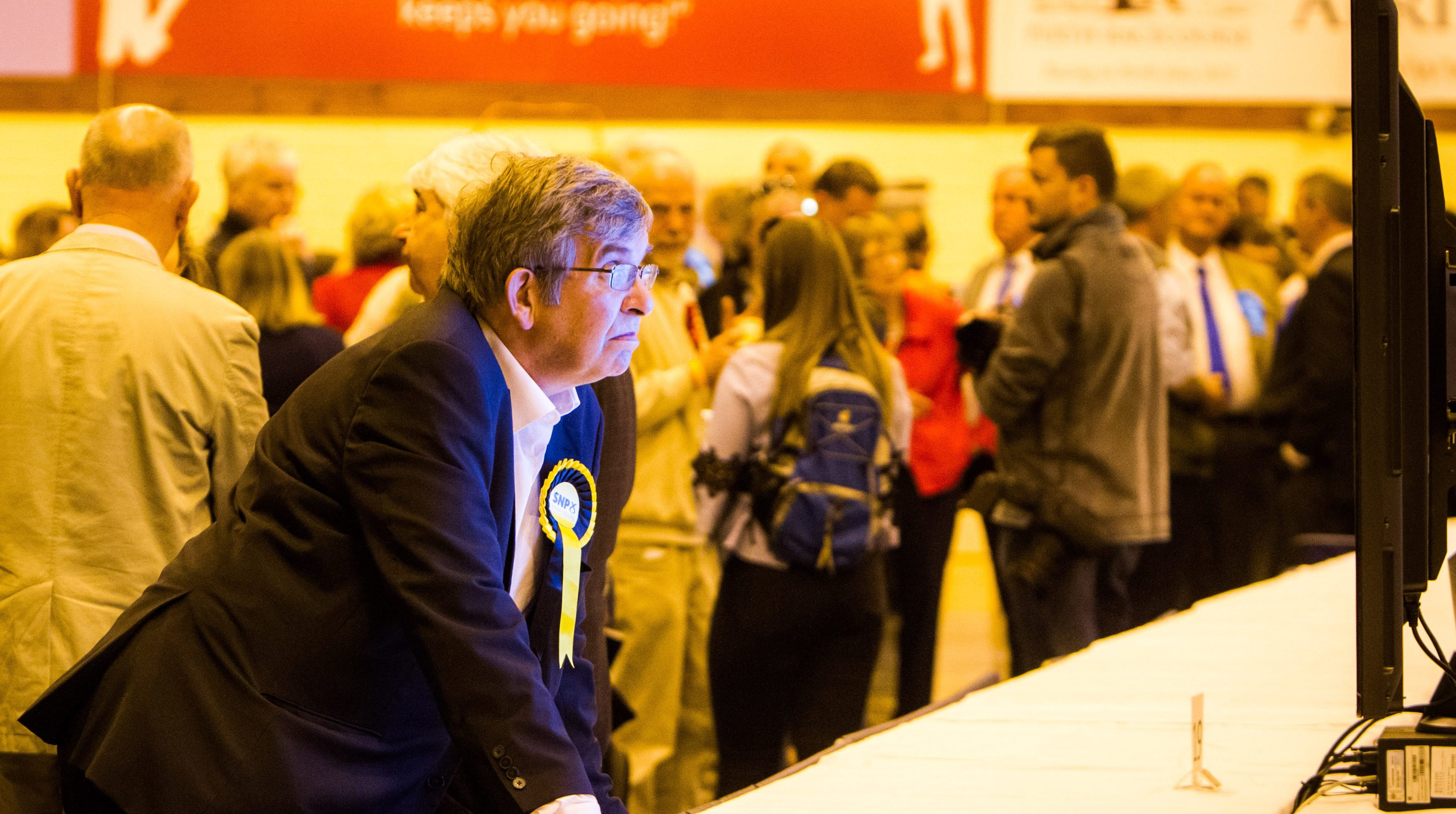 An SNP supporter seeing blue on the screen.