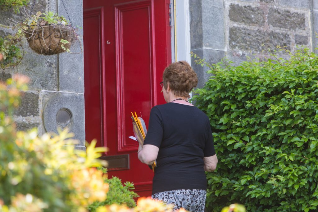 Elizabeth knocking on doors.