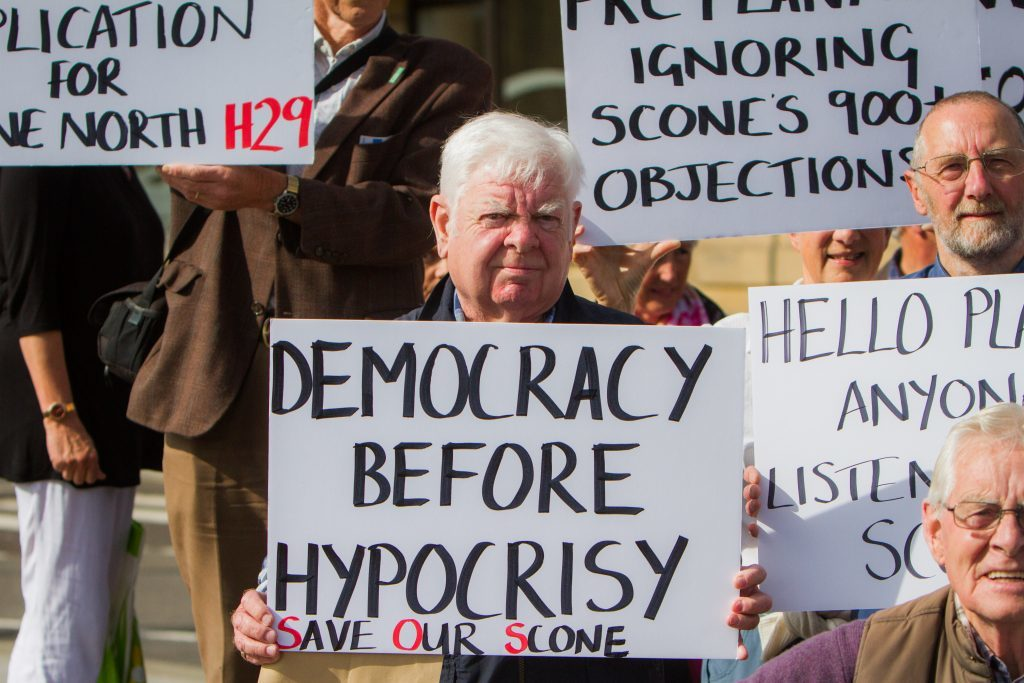 Protests before council meeting regarding housing application for Scone.