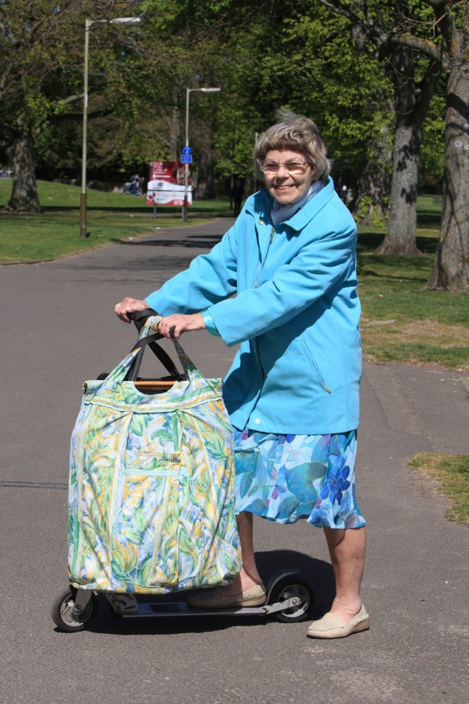 Barbel balances shopping bags on her scooter - the more the better!