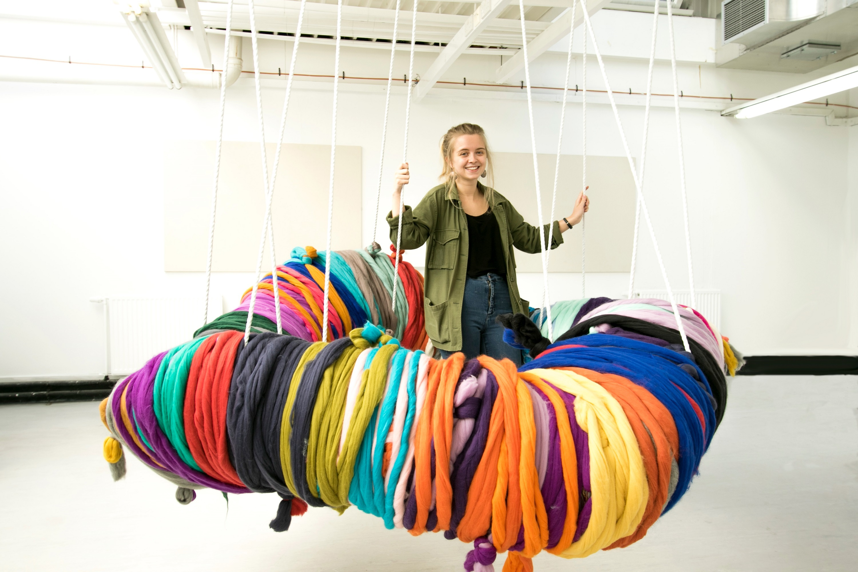 Shannon Murray with the giant pom-pom she is collaborating with the public on for her Degree Show exhibit.
