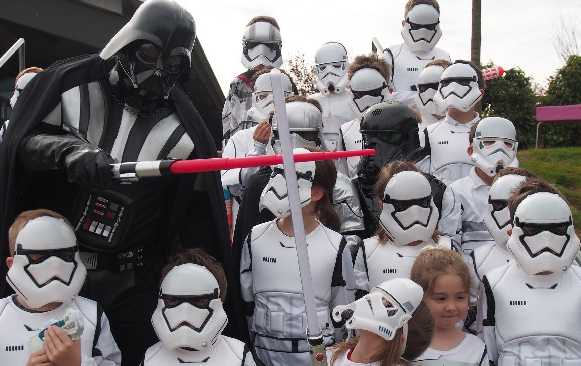 Darth Vader (head teacher Stuart Clyde) greets his army of diminutive stormtroopers at The Community School of Auchterarder.
