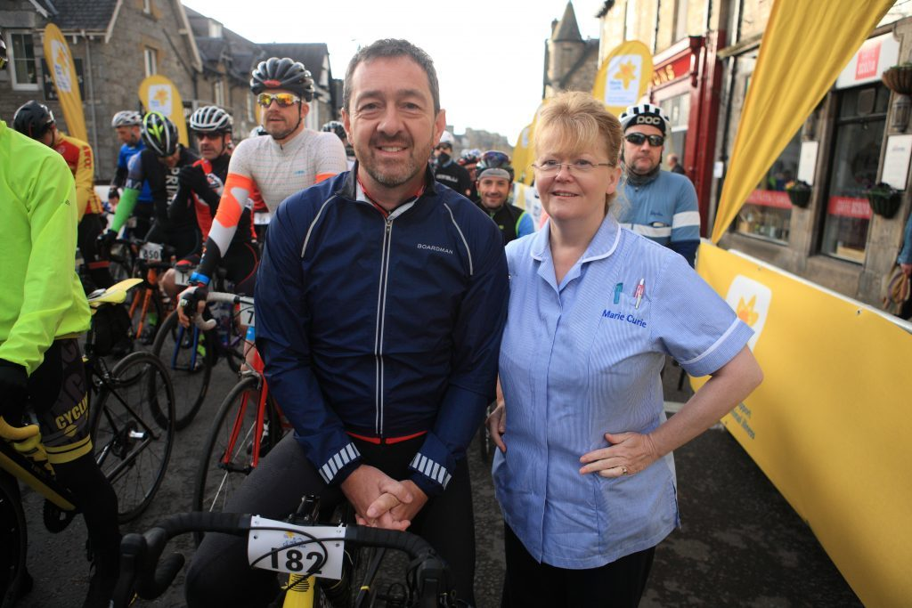 Chris Boardman at the start line with Marie Curie nurse Heather Inglis.