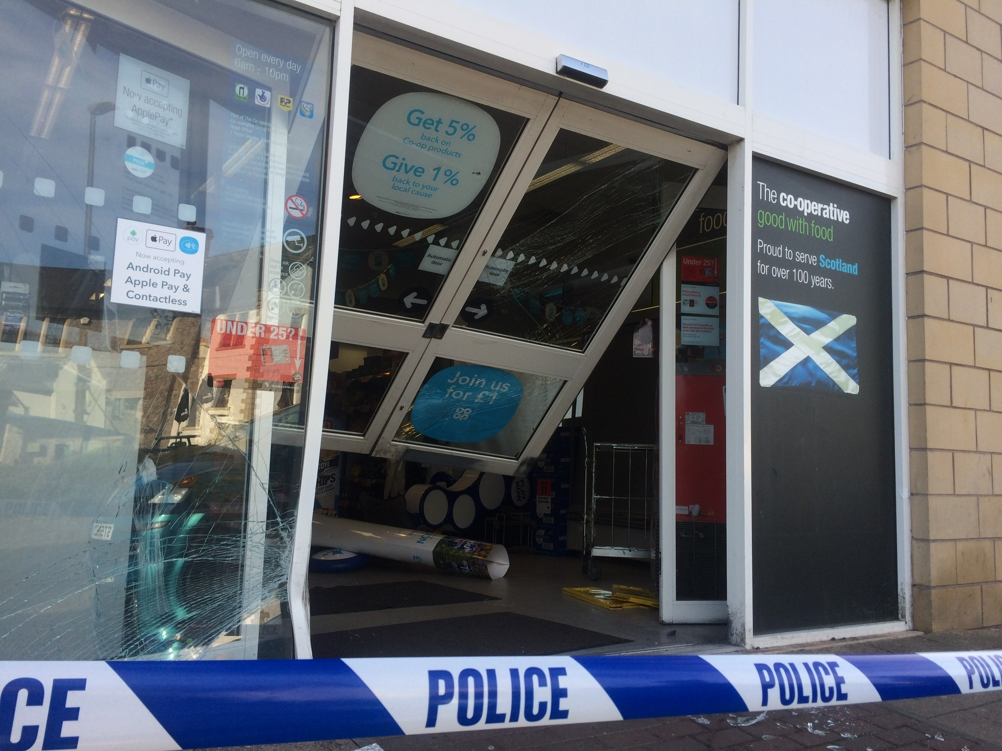 The smashed door at Co-op in Panmurefield.