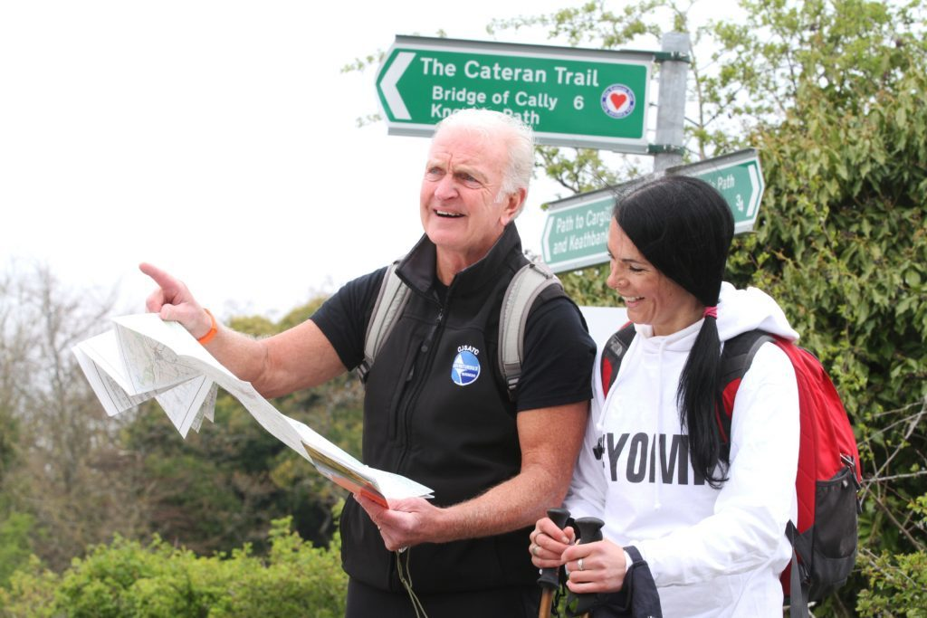 Mike Mooney and Gayle Ritchie doing a spot of map reading ahead of the Yomp.