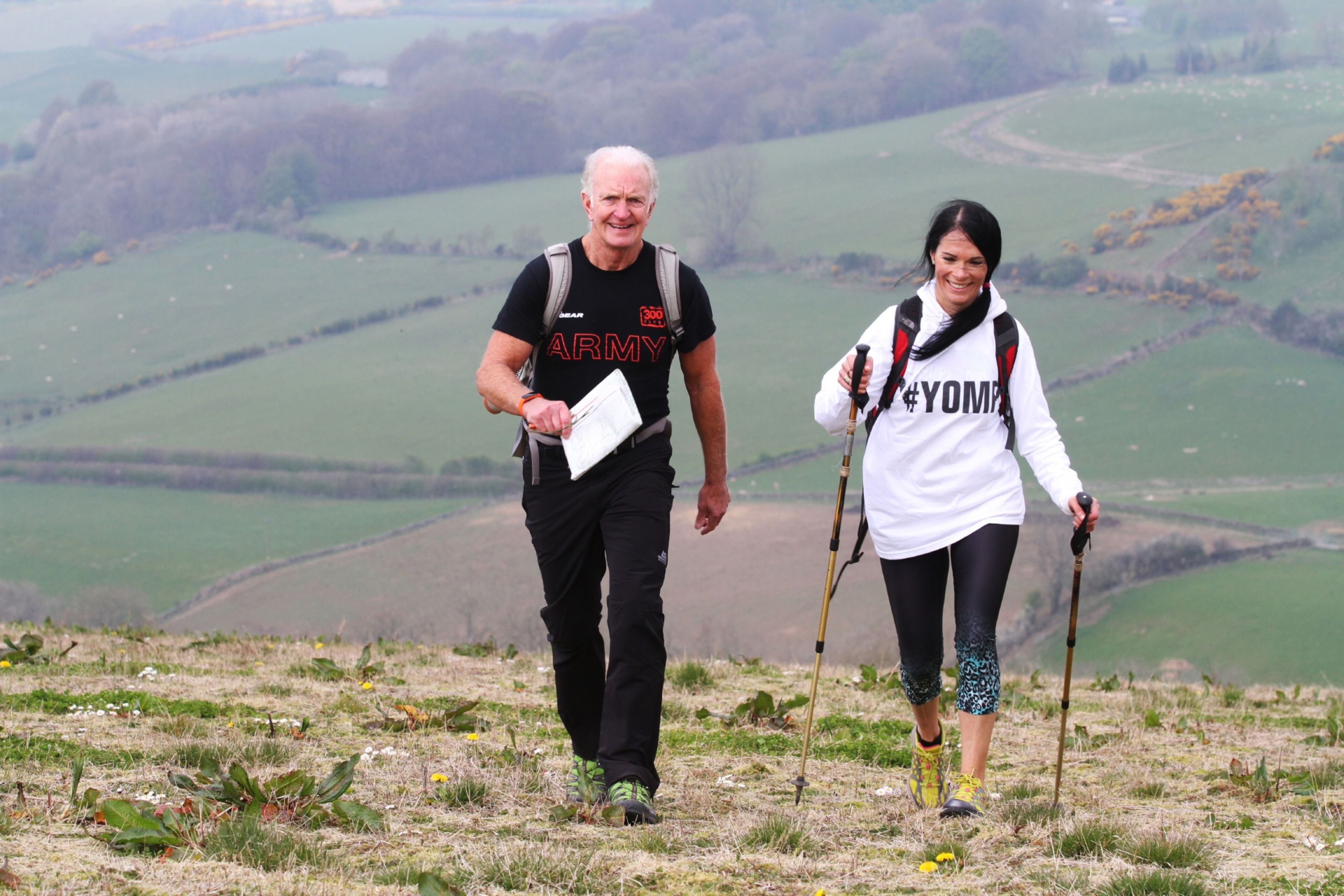 Yomp boot camp trainer Mike Mooney shows Gayle how to use walking poles effectively.