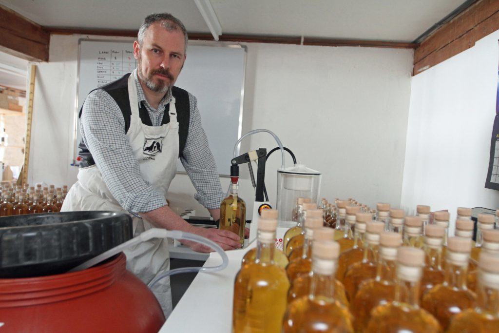 Christopher bottling his product in Blairgowrie.