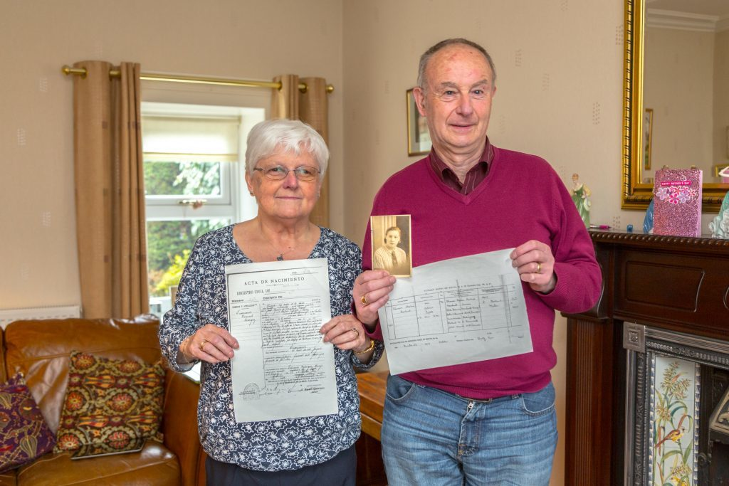 Thomas Borland and his wife Alison hold the Birth Certificate, Marraige Certificate and photograph of Thomas' mother Encarnacion Buenavente