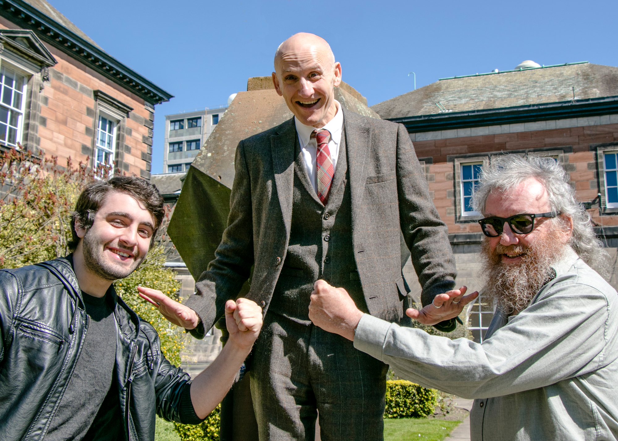 Professor Fordyce Davidson (middle) keeps student Rory McDowell (left) and graduate Iain Brodie (right) at bay ahead of next Saturday's event