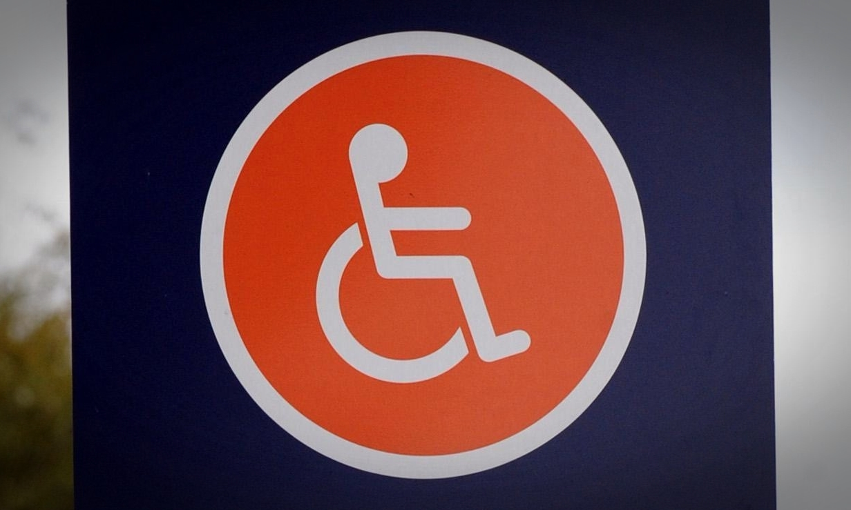 Disabled parking spaces sign at a Sainsburys store in London.