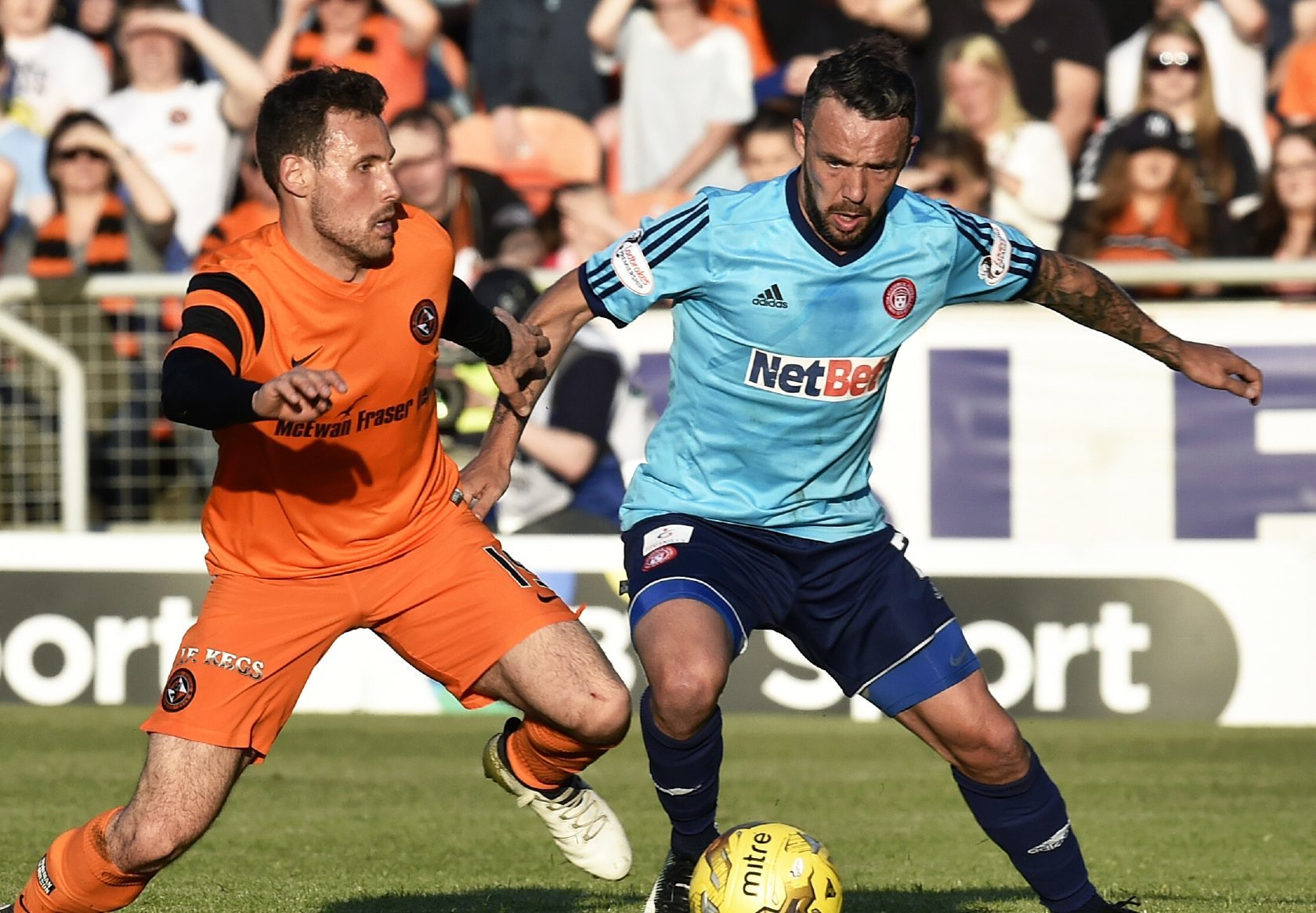 Dougie Imrie holds off Tony Andreu of United.