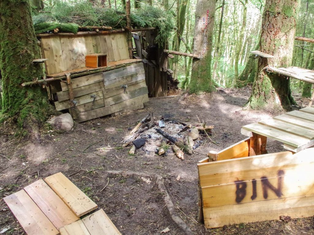 The den, together with a fire pit, caused considerable damage.
