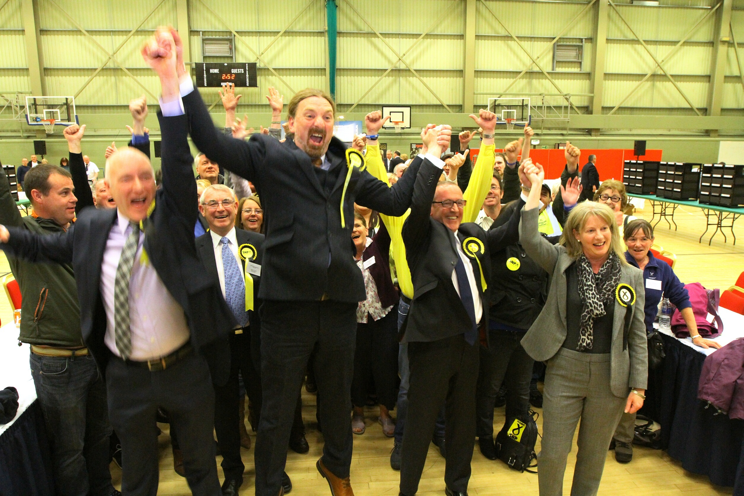 Chris Law and Stewart Hosie celebrate at the 2015 general election count.