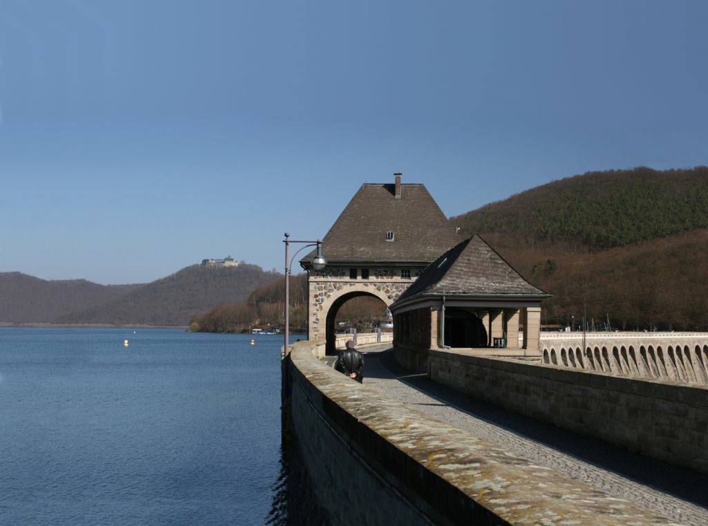Reservoir Edersee and dam with the castle of Waldeck in the background.