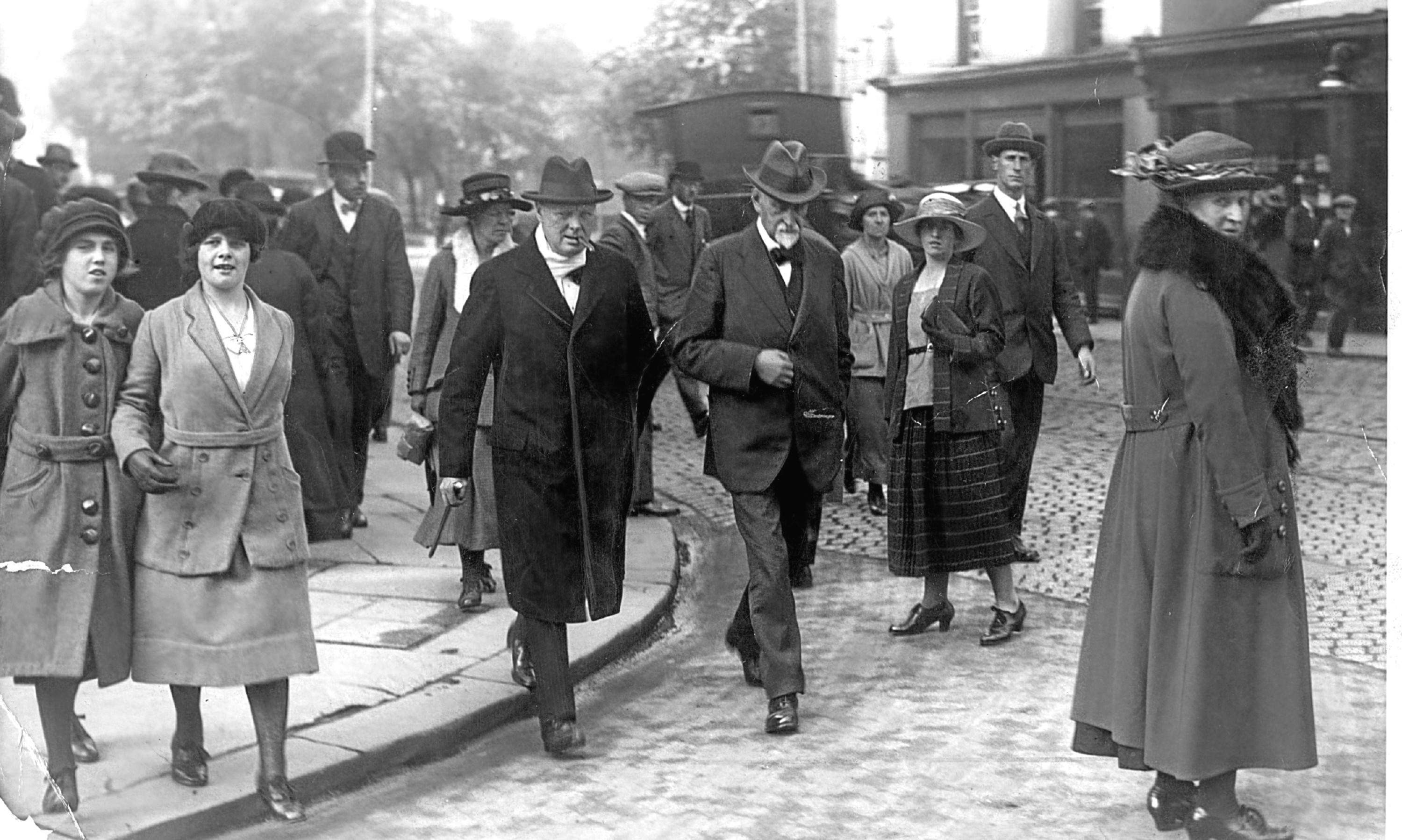 Winston Churchill and his entourage in his Dundee parliamentary constituency.