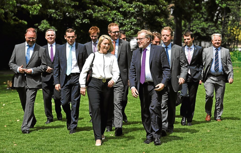 Scotland Secretary David Mundell joins Scotland's 12 new Conservative MPs at Victoria Park in Westminster, London, following last week's general election.