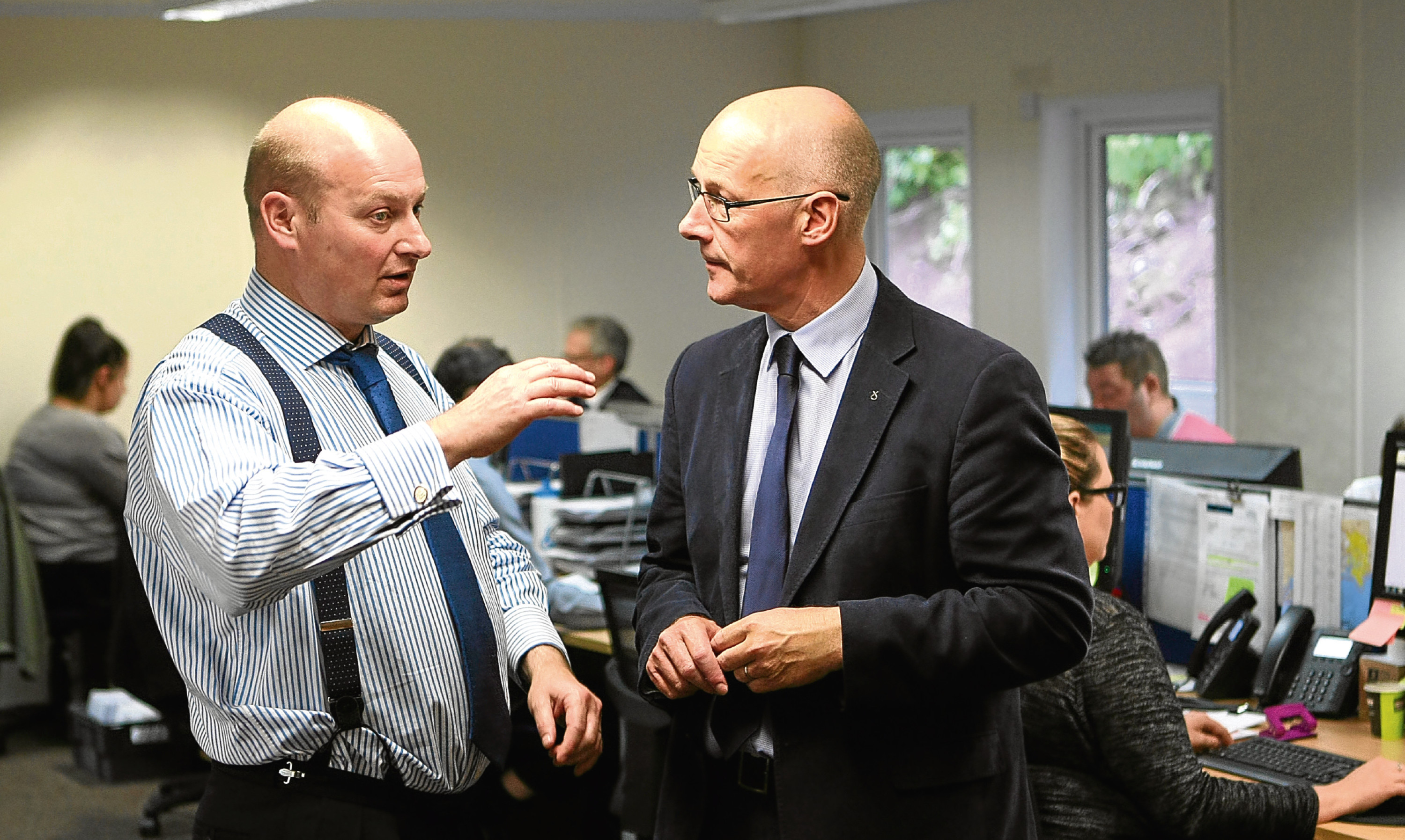 Castle Water CEO John Reynolds chats with Deputy First Minister John Swinney during a visit to the groups Blairgowrie headquarters last year.