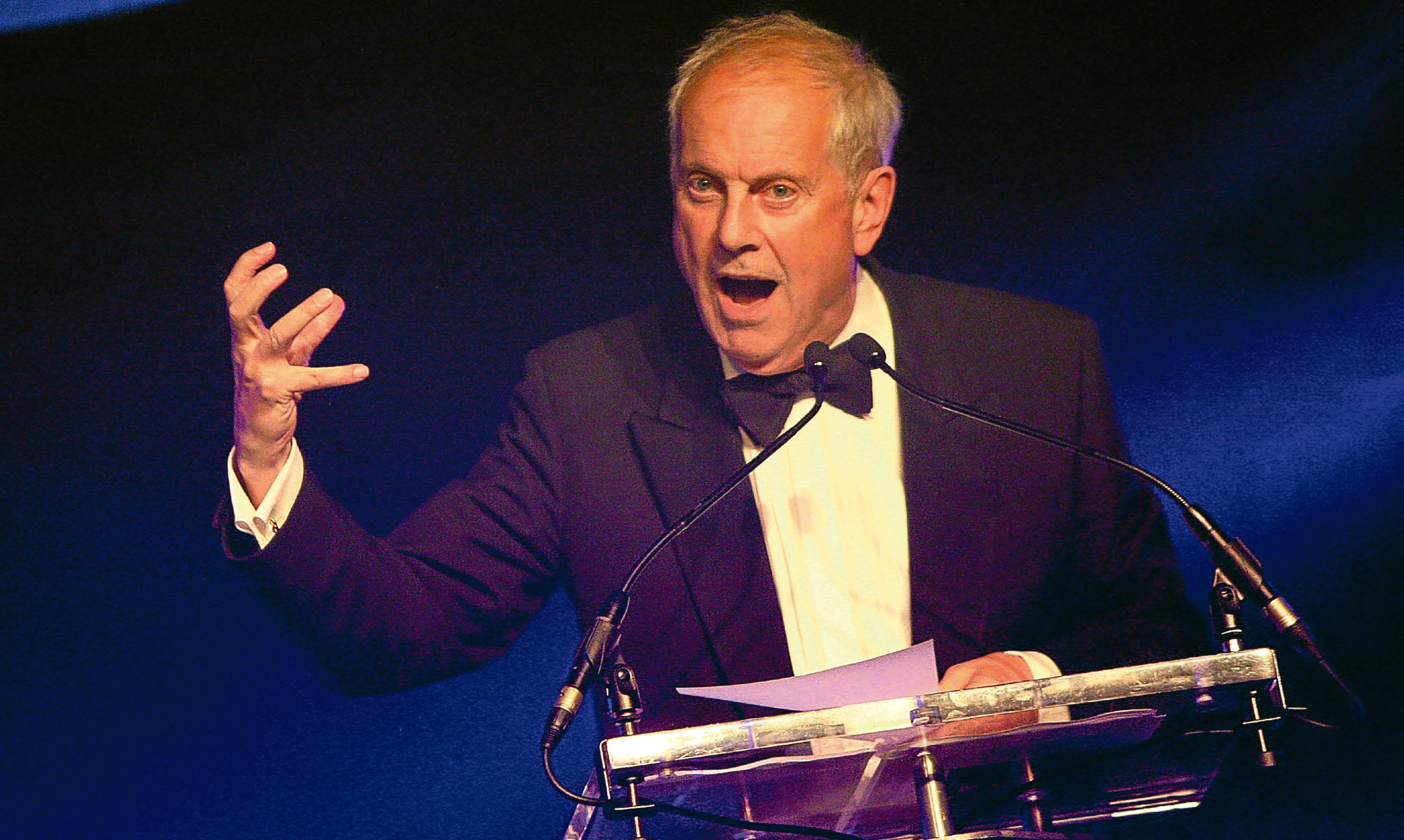 Gyles Brandreth takes charge at the 2016 Courier Business Awards. He is to return for 2017.
