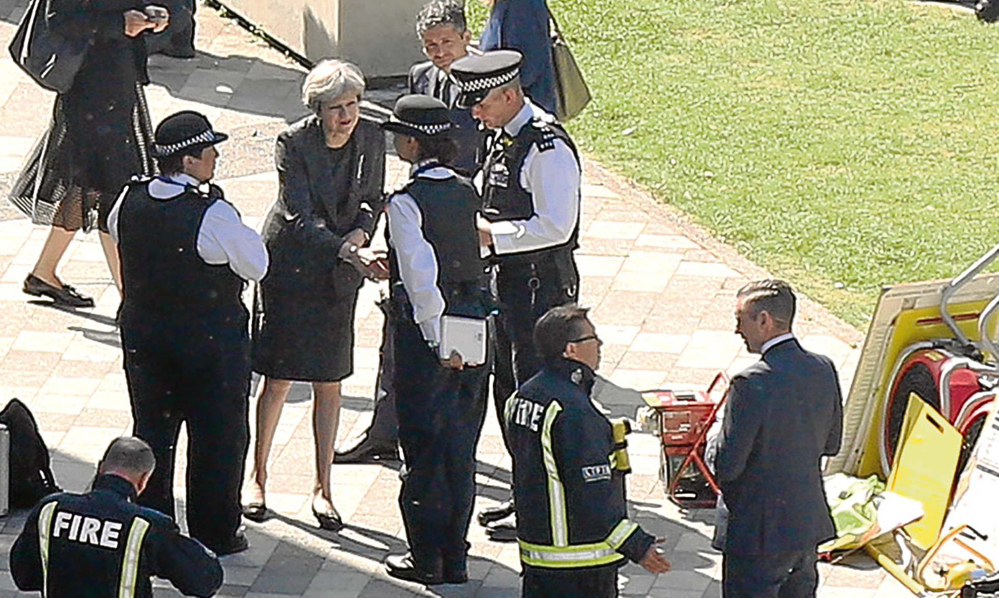 Theresa May during her much-criticised visit to Grenfell Towers.