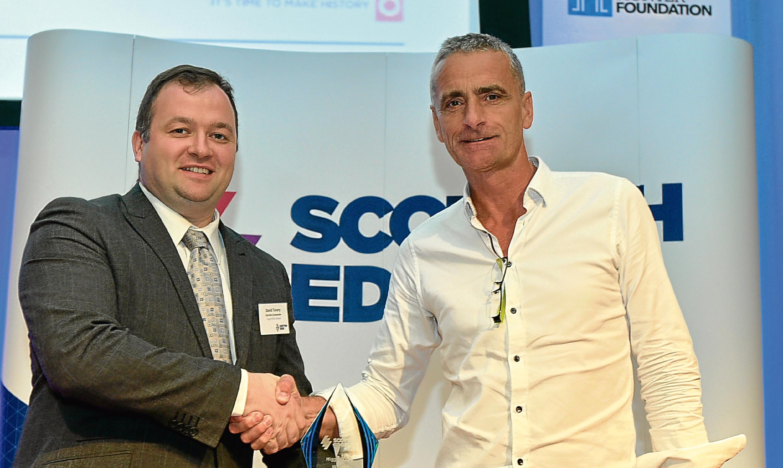 David Tonery receiving Higgs EDGE award from Ewan Hunter, CEO of the Hunter Foundation
