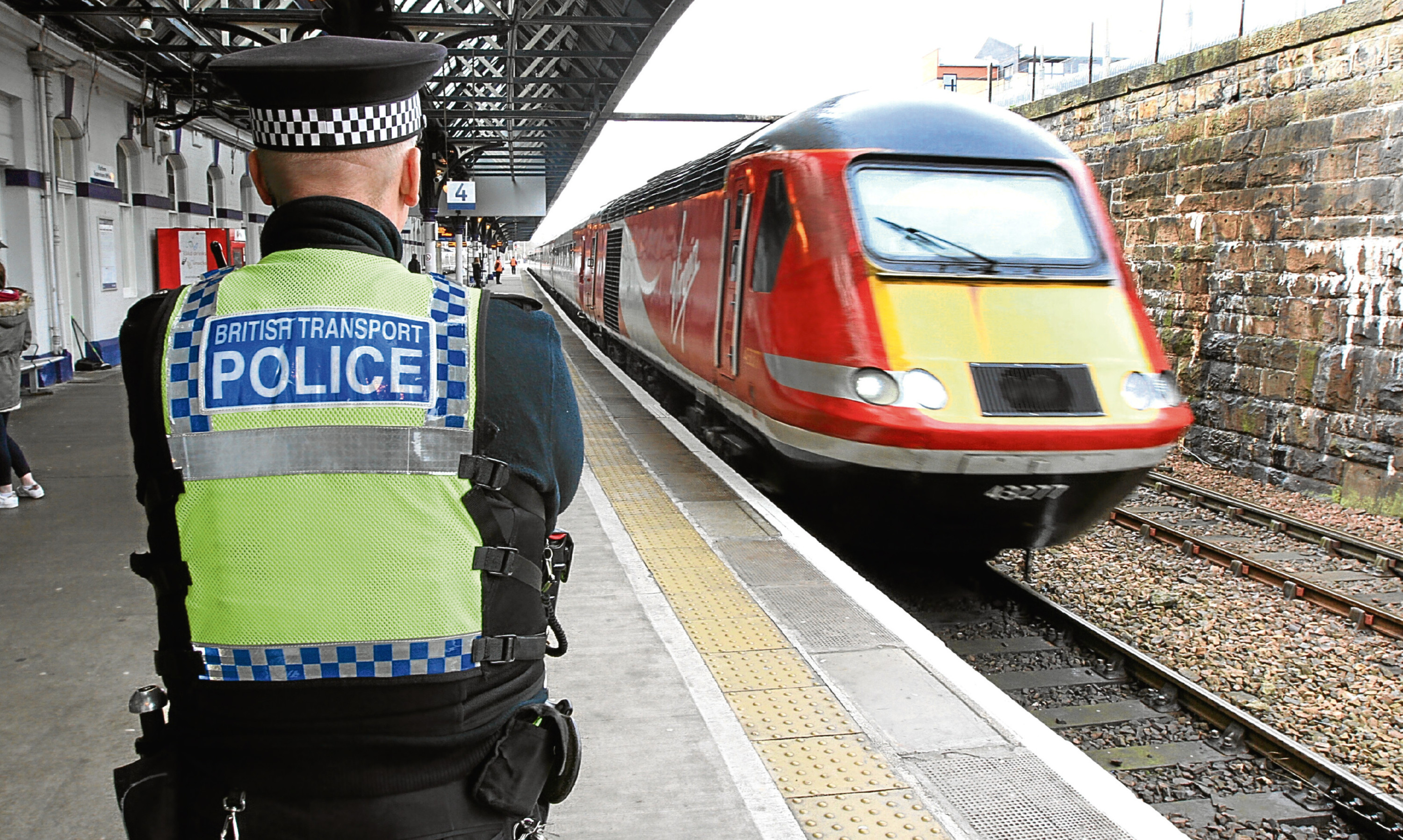 A British Transport Police officer on duty at Dundee railway station.