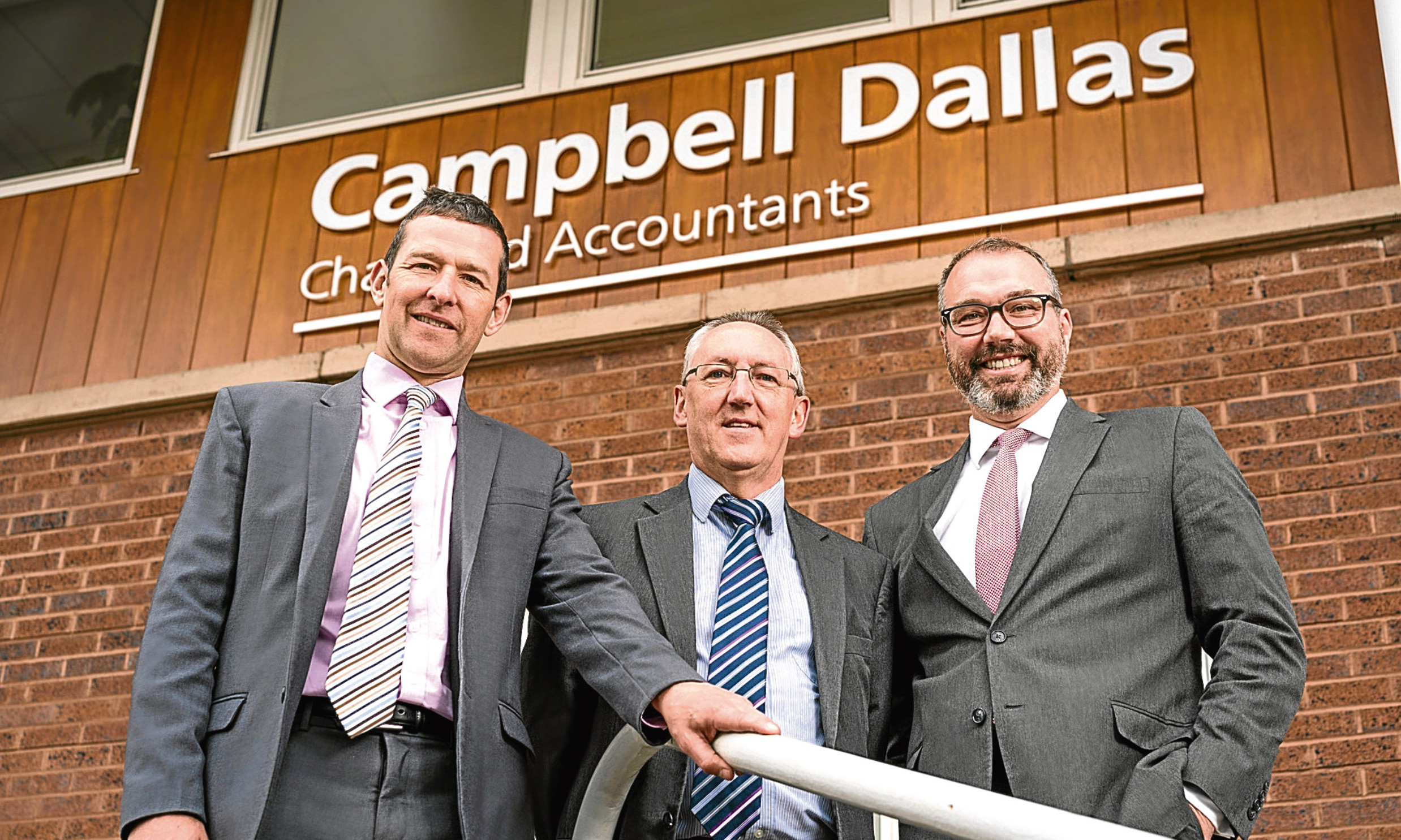 Andy Ritchie, Charlie Carnegie and Chris Horne outside Campbell Dallas Perth office after finalising the acquisition of Bell & Company.