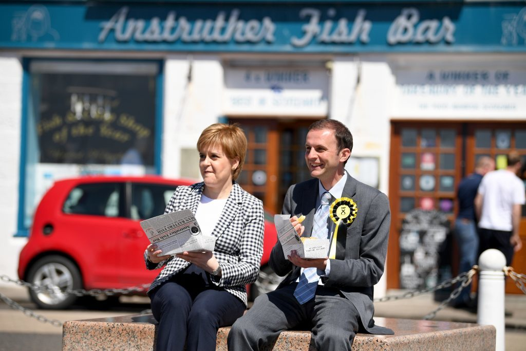SNP leader Nicola Sturgeon eats chips as she campaigns with Stephen Gethins in Anstruther ahead of last year's general election.