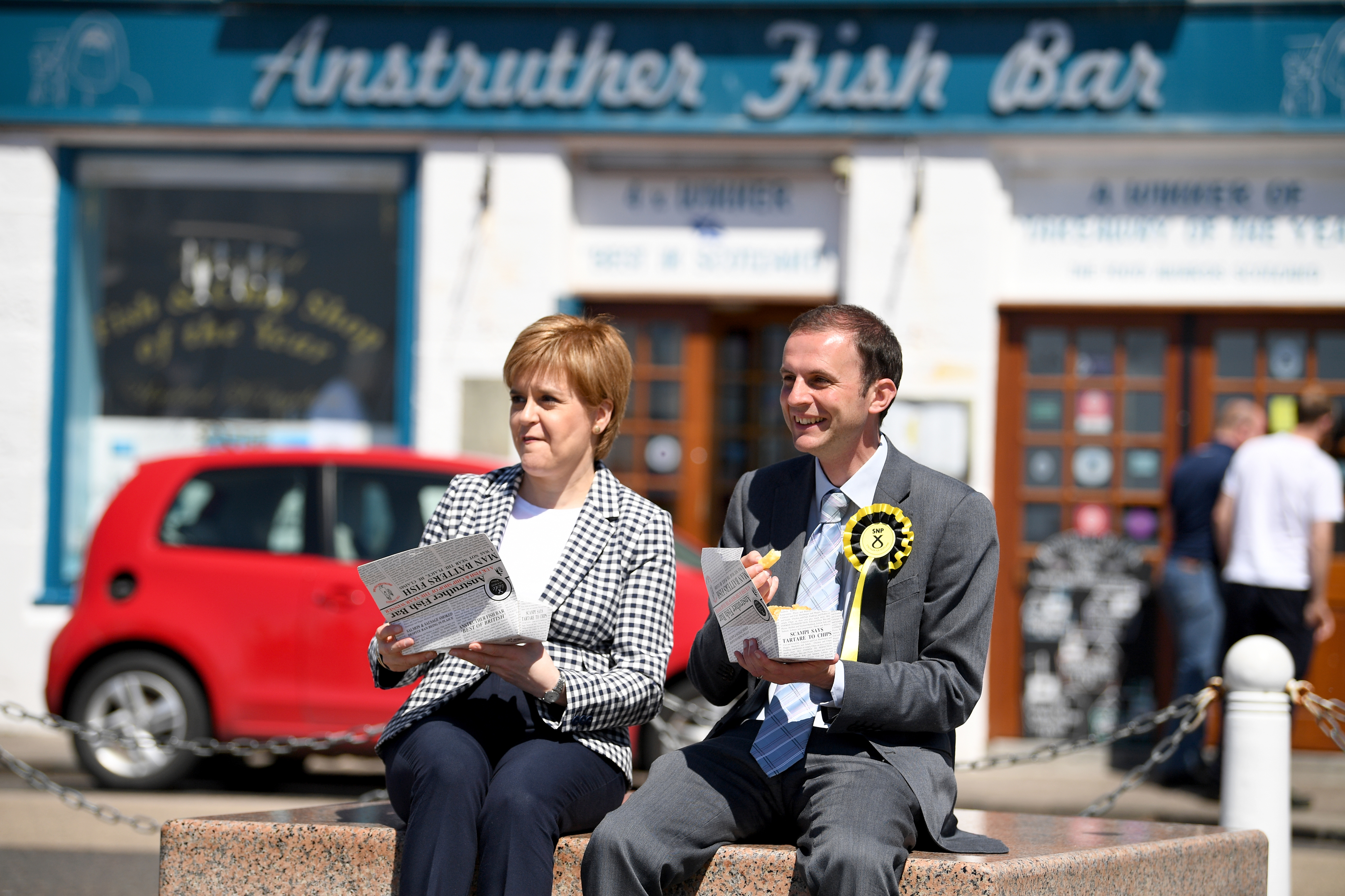 SNP leader Nicola Sturgeon eats chips as she campaigns with candidate Stephen Gethins in Anstruther.