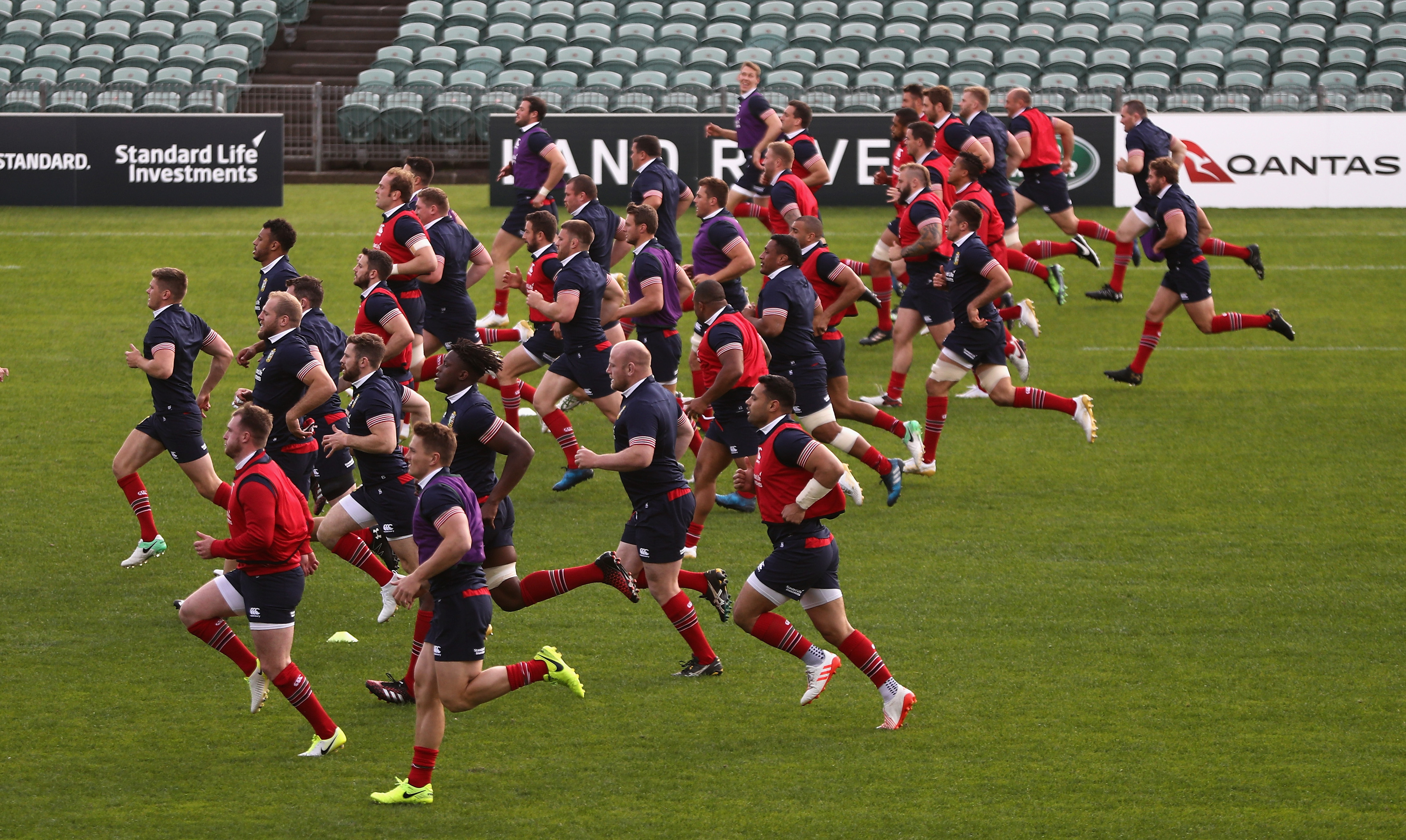 The Lions do a mass-up warm up in training at the QBE Stadium in Auckland.
