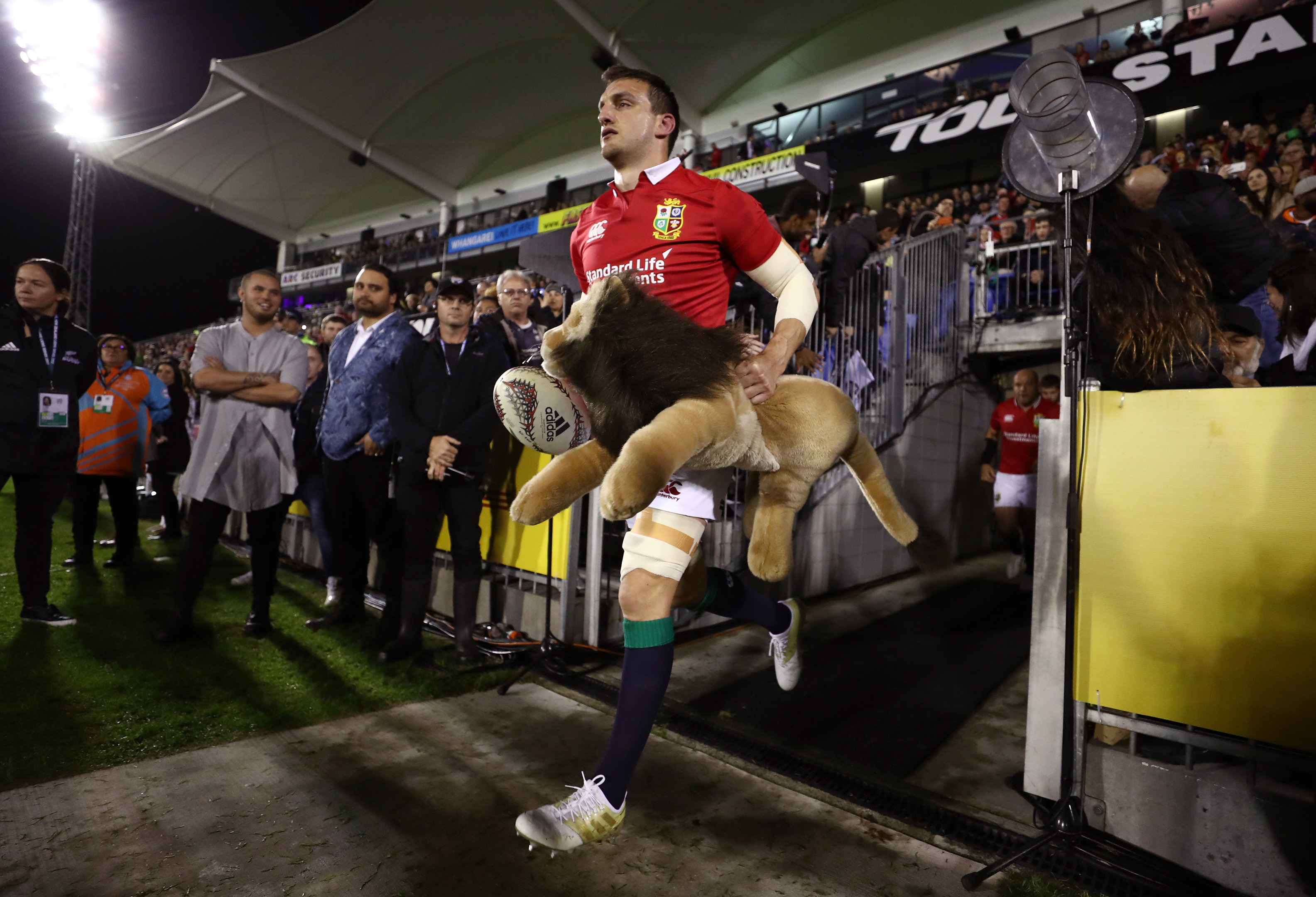 Captain Sam Warburton leads out the Lions for the opening match against the New Zealand Provincial Barbarians.