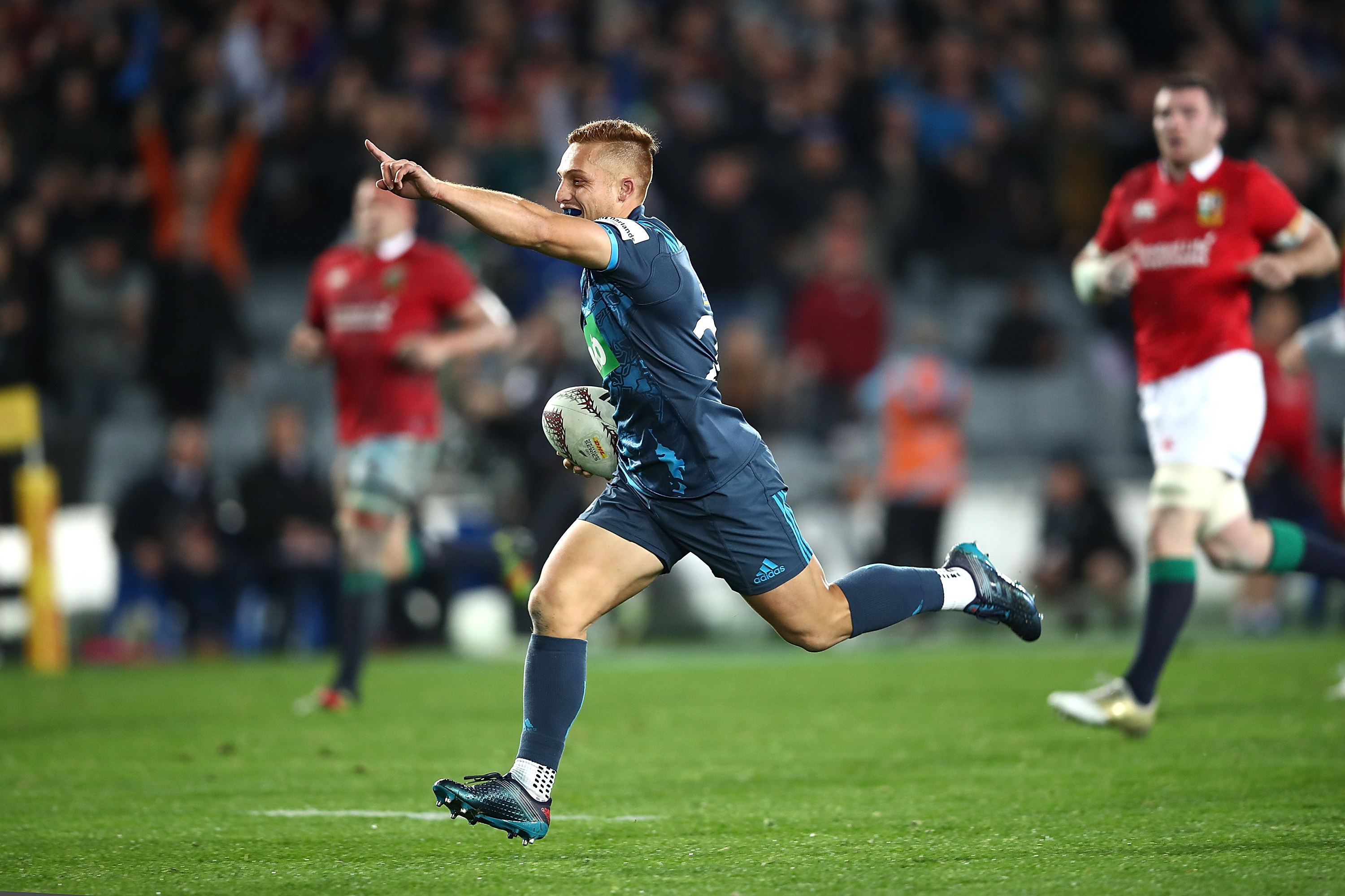 Ihaia West of the Blues celebates as he runs in to score the clinching try for the Blues against the Lions.