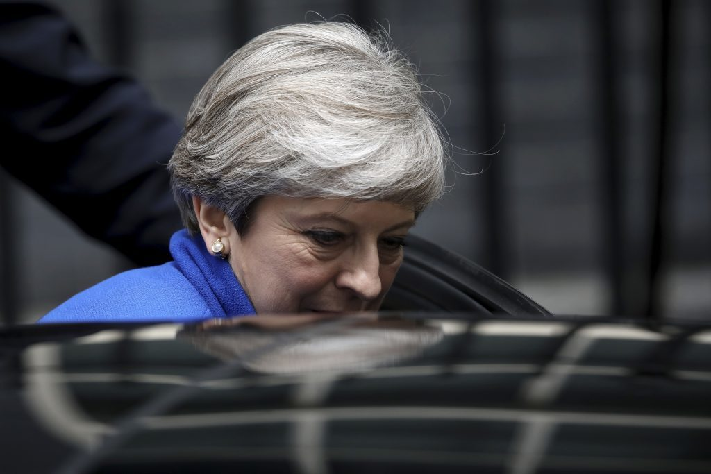 Theresa May leaves Downing Street to go to Buckingham Palace.
