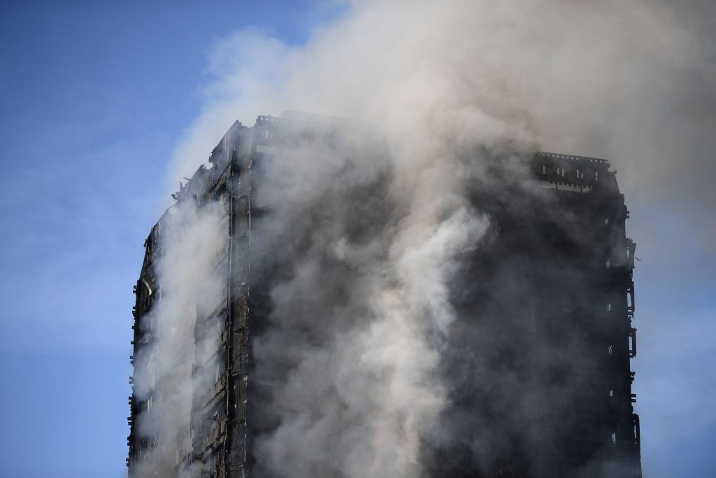 Smoke rises from the building after a huge fire engulfed the 24 story Grenfell Tower in Latimer Road, West London.