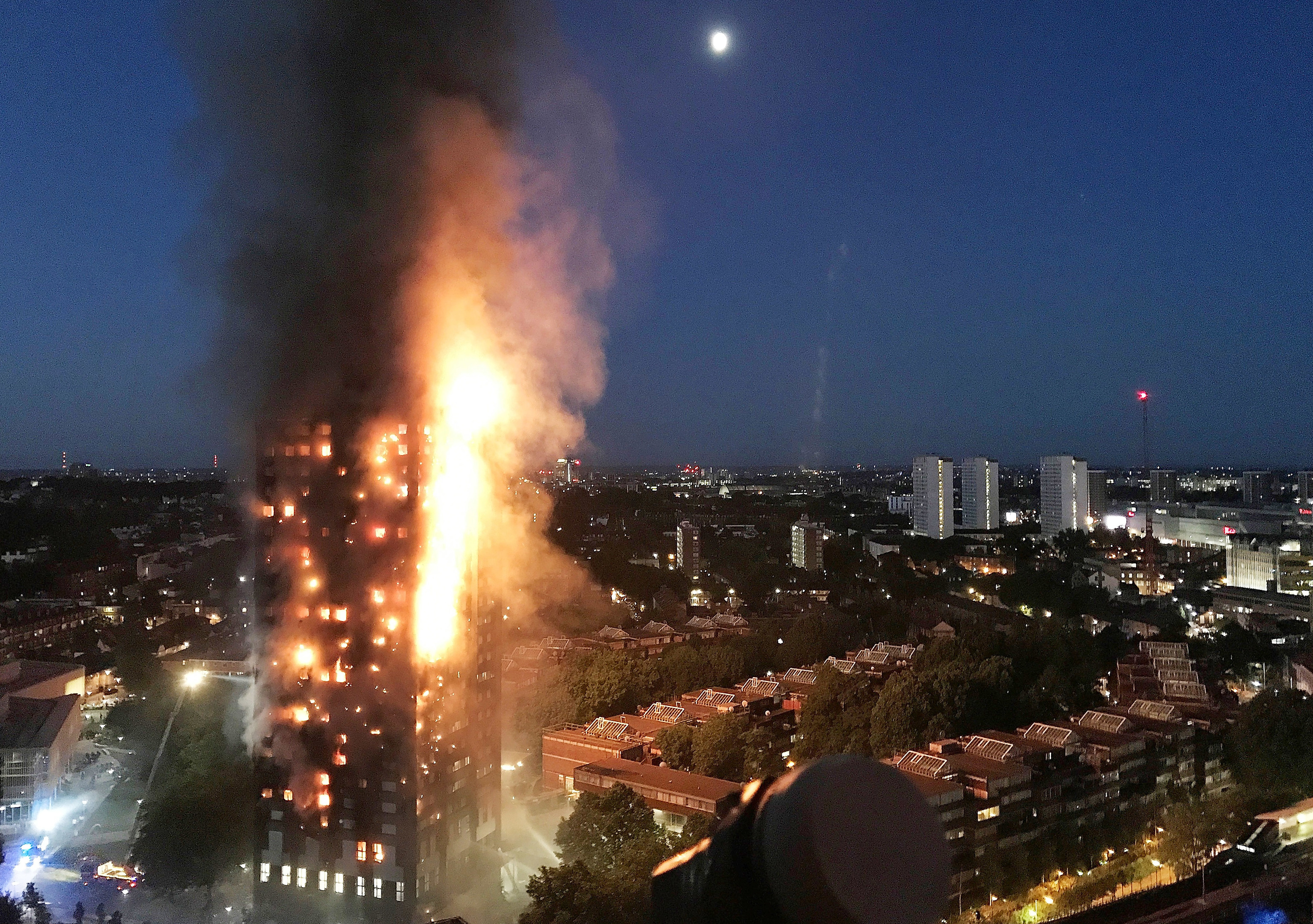 In this image taken by eyewitness Gurbuz Binici, a huge fire engulfs the 24 story Grenfell Tower in Latimer Road, West London.