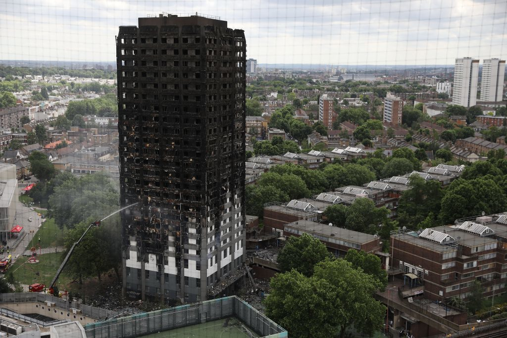 The blackened wreck of Grenfell Tower today.