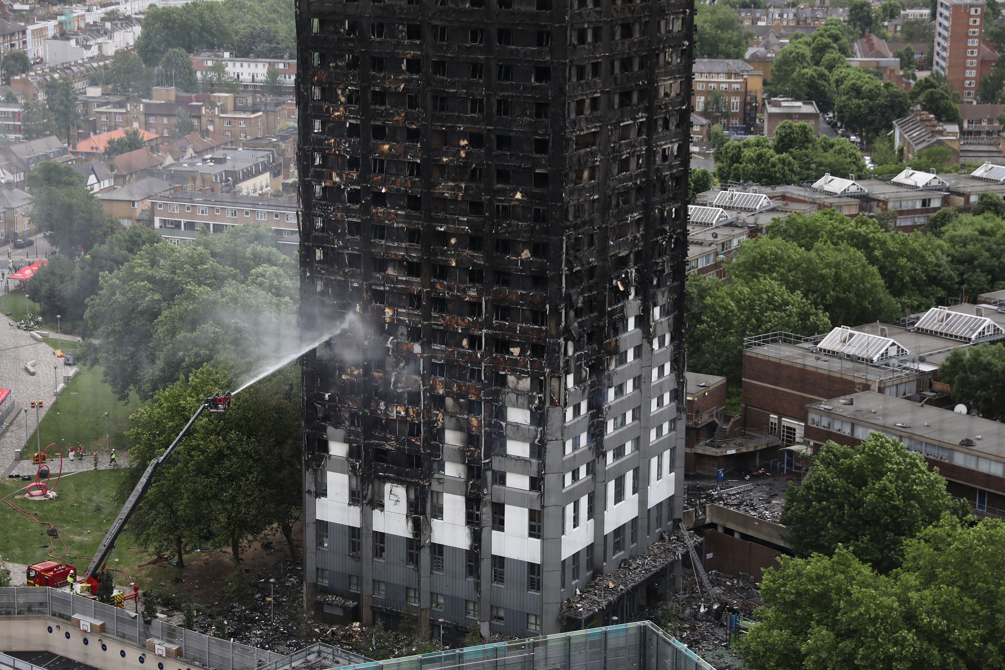 A hose dousing the fire at Grenfell Tower on June 15, 2017.