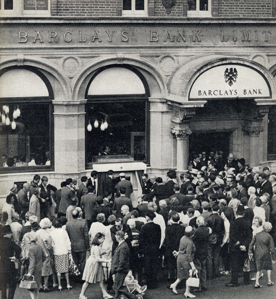 Crowds gather at the official opening of the worlds first ATM, installed at Barclays in Enfield, London on June 27 1967.