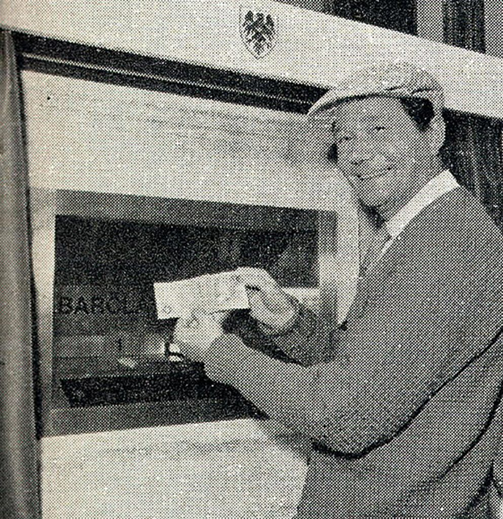 Actor Reg Varney at the official opening of the worlds first ATM, installed at Barclays in Enfield, London on June 27 1967.