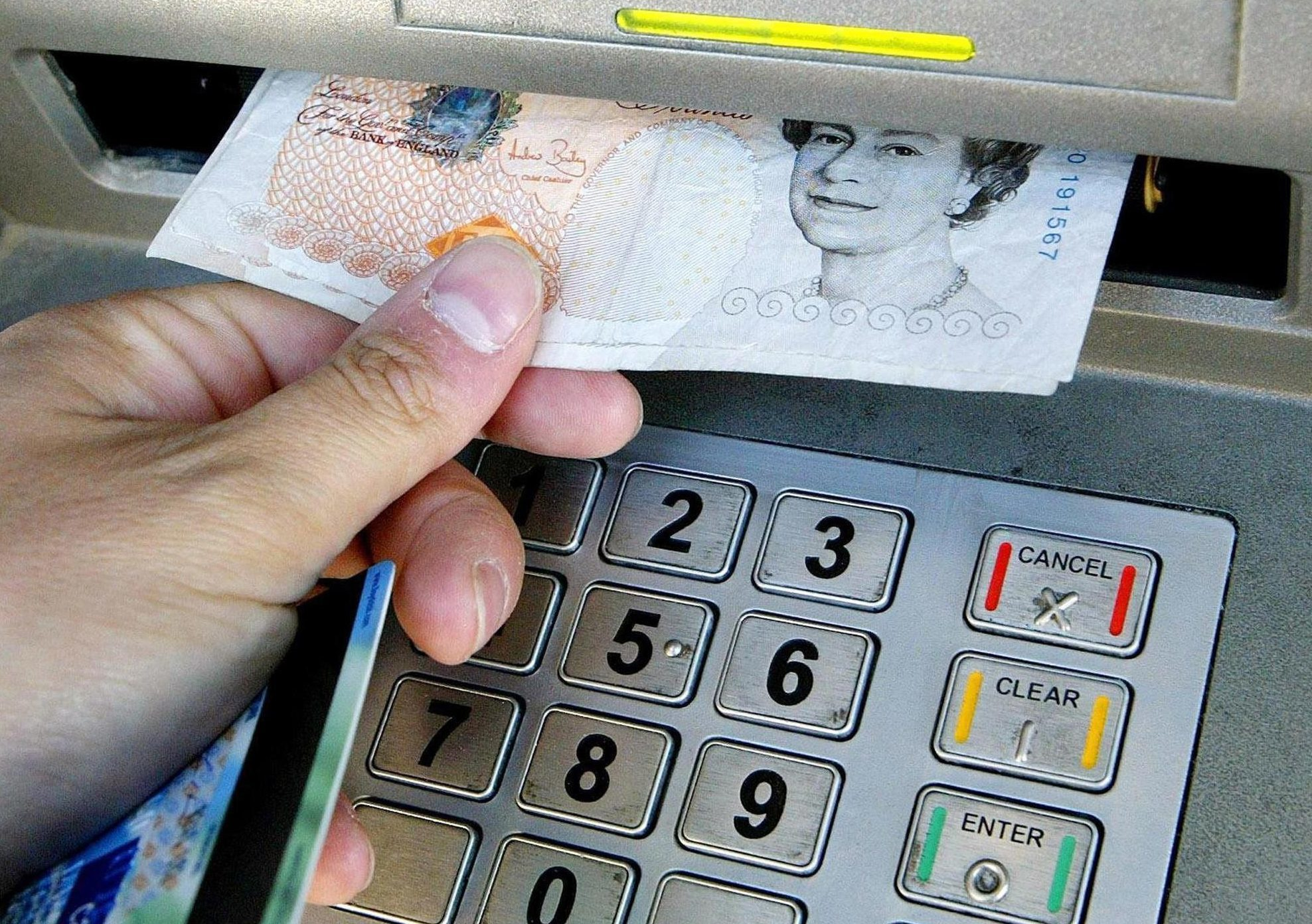 ATM charges would be banned under a Labour government, the party say.