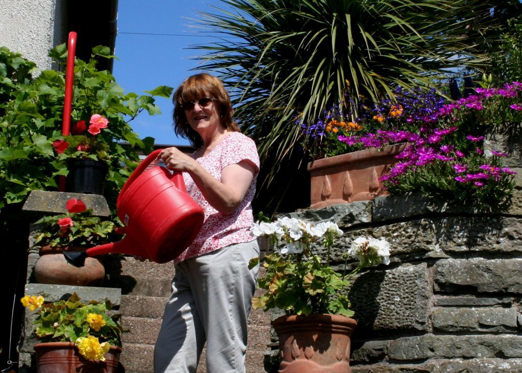 Anna watering the pots