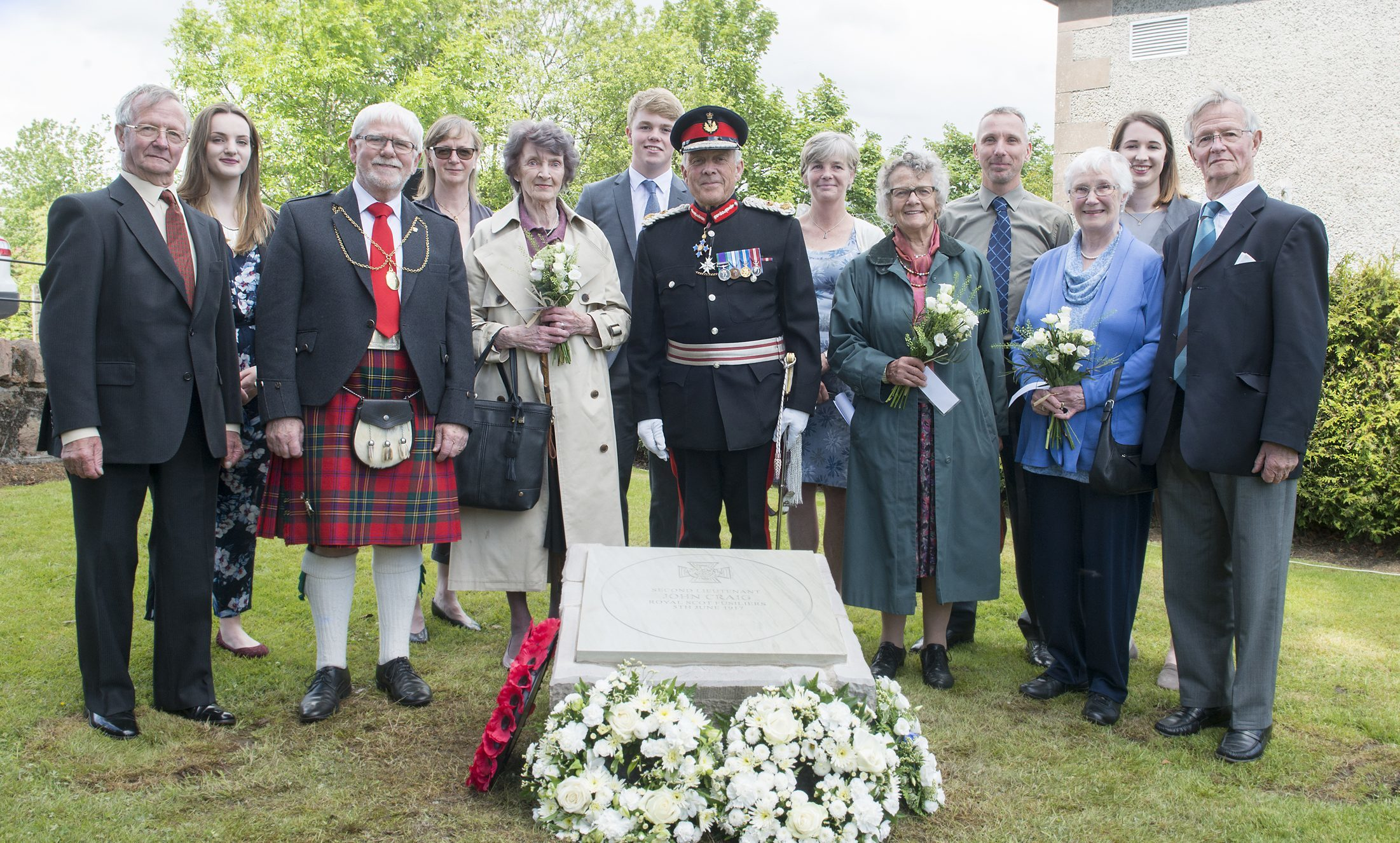 John Manson Craig VC  Photo, Pictured at the ceremony in Comrie, Lord Lieutenant Mel Jameson is Pictuerd With Perth Provost Dennis Melloy  and members of the John Craig family pictured by the memorial stone.