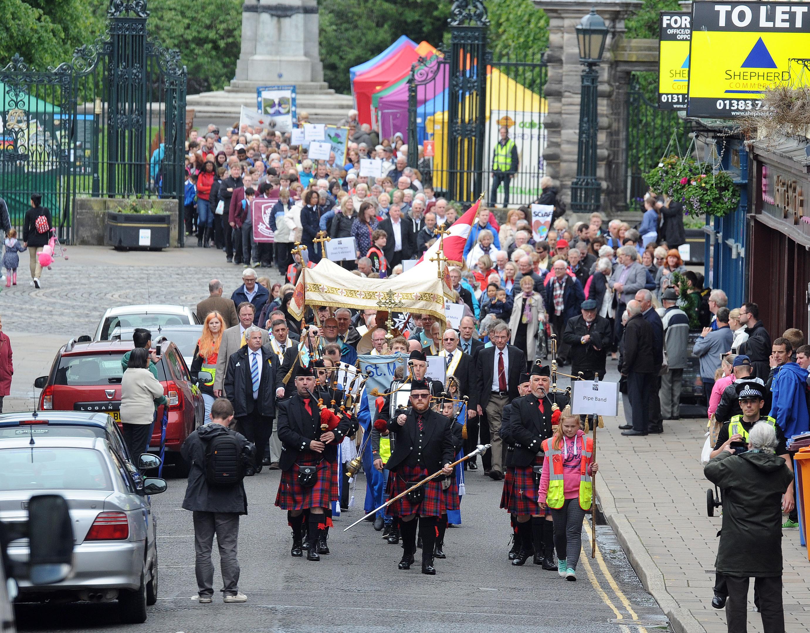 The Pilgrim's parade heads through Dunfermline.