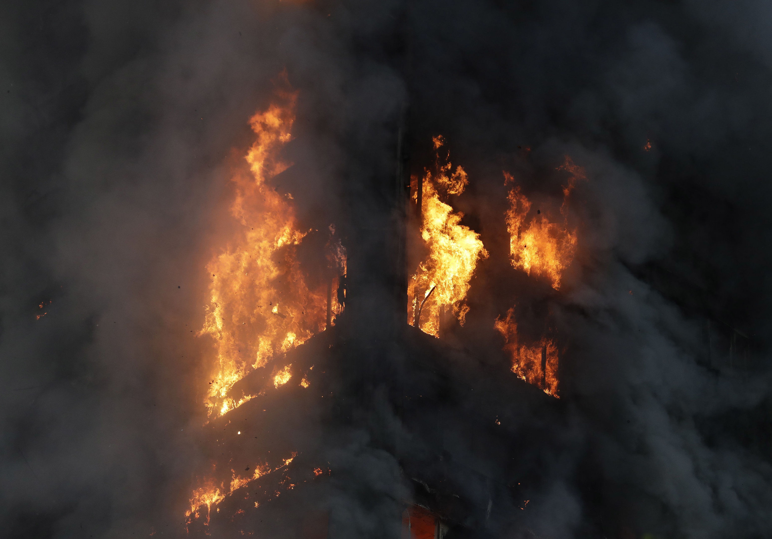 Smoke and flames rise from Grenfell Tower in London.