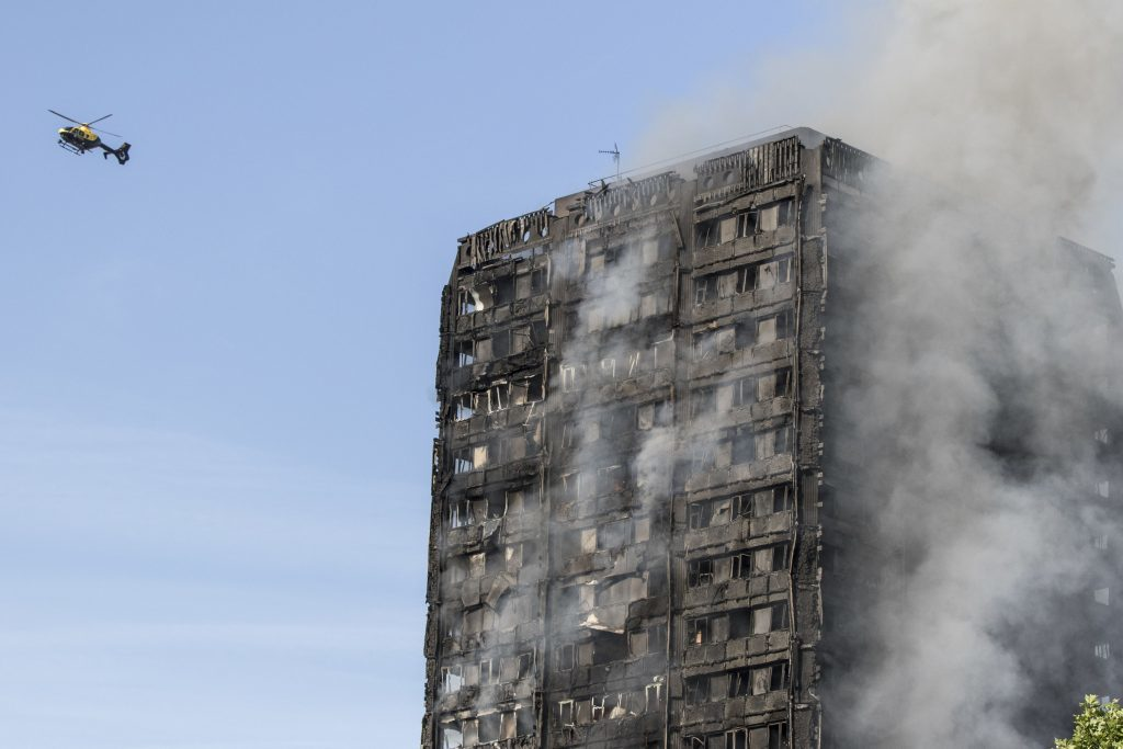 Smoke billows from a fire that has engulfed the 27-storey Grenfell Tower.